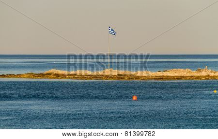 Greek Flag On Small Piece Of Land In The Sea
