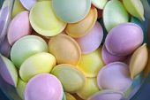foto of flying saucer  - background of flying saucer multi colored candy sweets - JPG