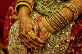 foto of henna tattoo  - Traditional henna on brides hands on wedding in Bangladesh - JPG