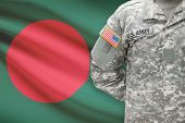 pic of bangladesh  - American soldier with flag on background  - JPG