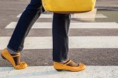 image of mary jane  - Woman passing crosswalk with yellow purse and yellow shoes - JPG
