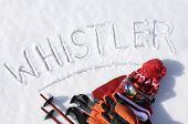 pic of goggles  - The word Whistler written in snow with ski poles goggles and hats - JPG