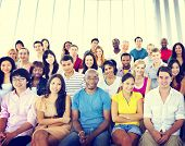 stock photo of audience  - Group People Crowd Audience Casual Multicolored Sitting Concept - JPG