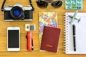 image of outfits  - Outfit of traveler with passport on wooden background - JPG