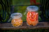 foto of jar jelly  - Fruit jelly slices in the glass jars at the party outdoors - JPG