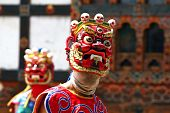 stock photo of tantric  - Two masked festival dancers in the kingdom  of Bhutan - JPG