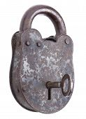 stock photo of theft  - Locked medieval padlock with key - JPG