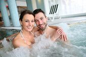 picture of health center  - Couple enjoying bath in spa center jacuzzi - JPG