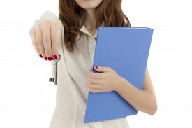 picture of hade  - Female real estate agent giving the key for the new home - JPG
