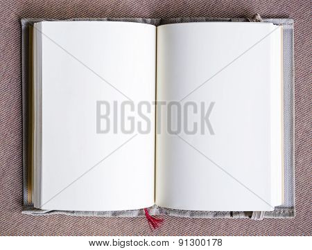 Blank book page open on table Top view