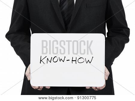 Businessman holding whiteboard with the words Know-How