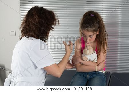 Female Doctor Injecting Vaccine To Young Girl