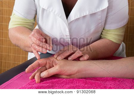 Man In An Acupuncture Therapy In A Spa Center