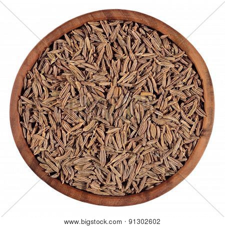 Cumin Seeds In A Wooden Bowl On A White