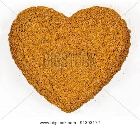 Curry Powder In The Form Of Heart On A White