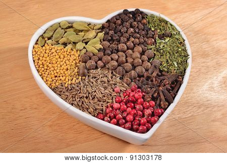 Different Dry Spices In Plate In Form Of Heart