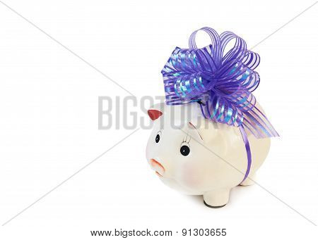 Piggy Bank With Big Violet Bow Isolated On White....