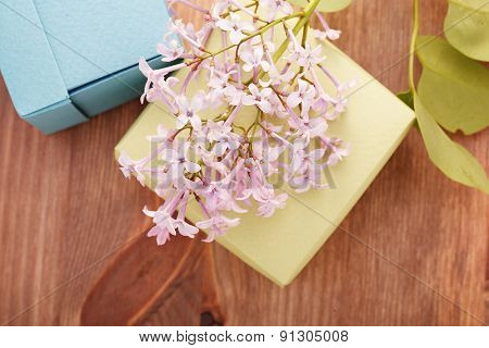 Paper Boxex And Flowers On Wooden Table