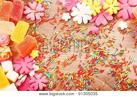 Sweets And Candies On A Wooden Table