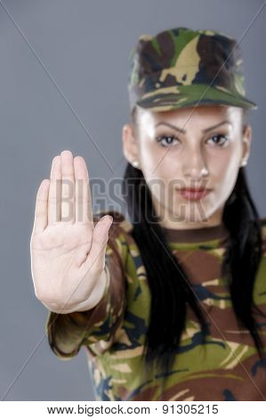 Soldier Woman Showing Palm Stop Sign On Gray Background
