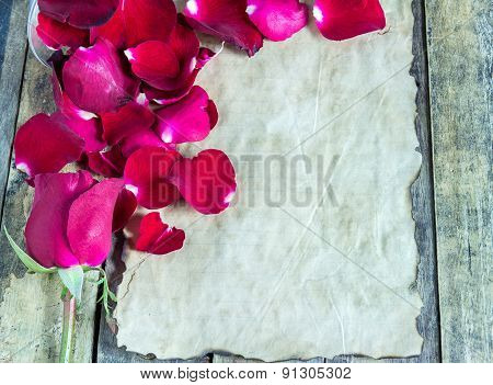 Fresh Red Rose And Old Paper On Wooden Background.