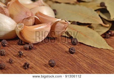 Garlic, Bay Leaves And Peppercorns