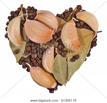 Garlic, Bay Leaves And Peppercorns In The Form Of Heart On A Whi