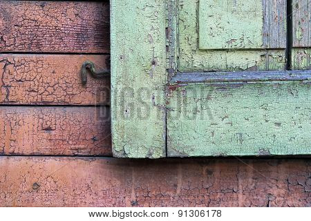 Fragment Of Wooden Shutters On An Old House Wall