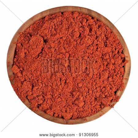 Ground Paprika In A Wooden Bowl On A White
