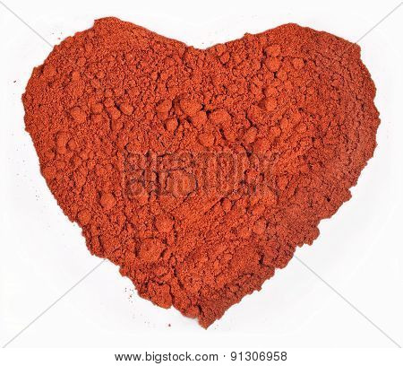 Ground Paprika In The Form Of Heart On A White