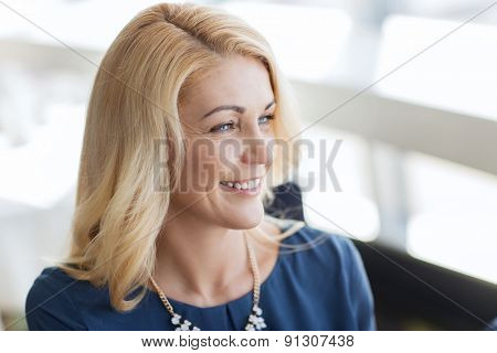 people, women and lifestyle concept - happy smiling blonde woman in blue clothes