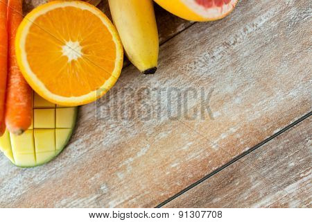 healthy eating, food and diet concept- close up of fresh juicy fruits on table