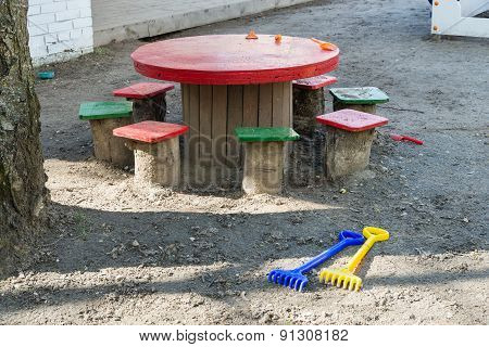 Table, Stools, Toys On The Playground