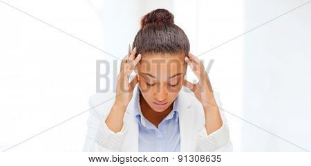 business, tax, deadline concept - african businesswoman working with calculator and clock in office