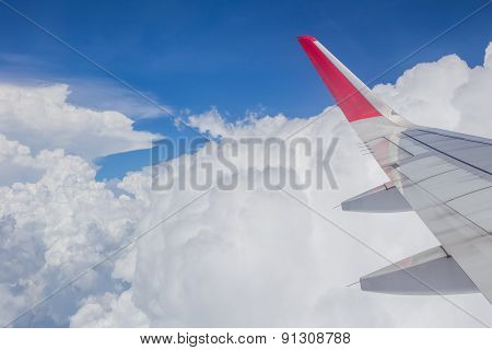 Cloudy Sky And Airplane Wing View From Window