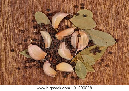 Heap Of Garlic, Bay Leaves And Peppercorns