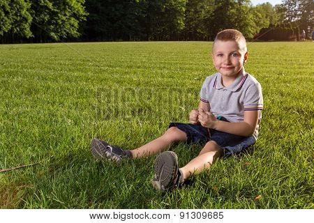 happy little boy laying on the grass