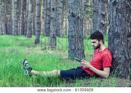 Boy Under A Tree
