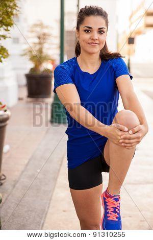 Happy Runner Stretching Legs