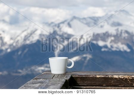 Cup Of Tea On Mountains Background