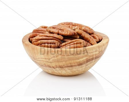 Pecan halves in a bowl isolated on a white