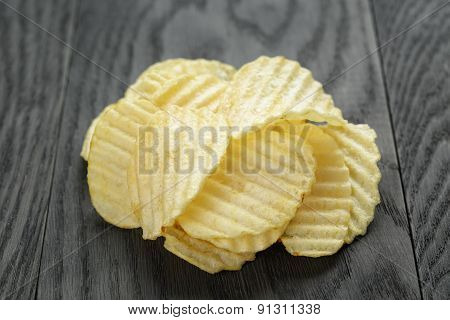 rippled organic chips on wooden table