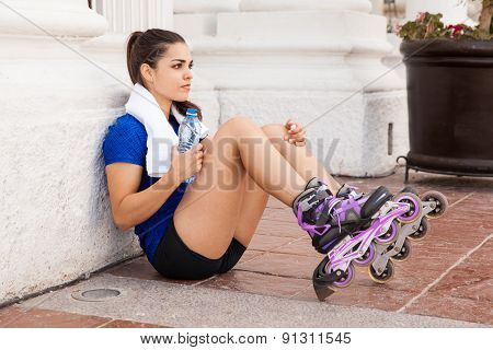 Cute Female Skater Drinking Water