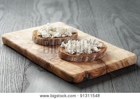 rye sandwich or bruschetta with ricotta cheese and herbs