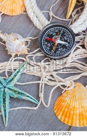 compass on fishing net with tag