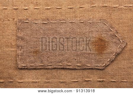 Arrow Made Of Burlap  Lies On A Sacking  Background