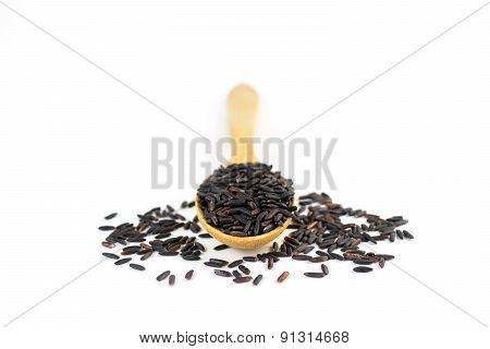 Riceberry On Wooden Spoon Isolated On White