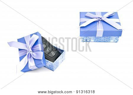 Car Keys And Blue Gift Boxes