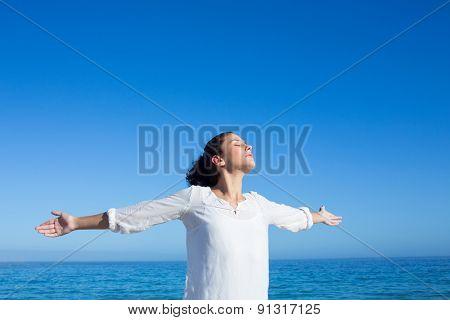 Brunette doing yoga at the beach