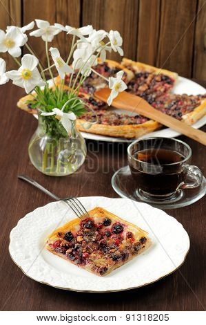Square Piece Of Berry Pie Served With Tea In Glass Cup And White Anemones